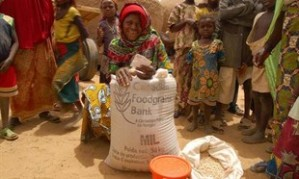 Ramatou Malon Hassan, a widow and mother of twelve in Niger, receives millet from CFGB to help her sustain her family through a crisis.