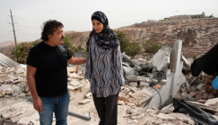 On Nov. 5, Salim and Arabiya Shawamreh stand among the ruins of their family's house, demolished for the sixth time four days earlier in the West Bank town of Anata. (Photo by Ryan Rodrick Beiler)