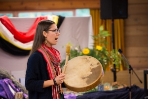 Janelle de Rocquigney leading a drum song. Photo credit Matthew Dueck for KAIROS Canada.