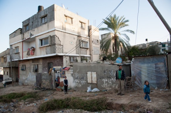 In December 2013, Hashem Al Attar stood in front of his tin-roofed, one-story, two-room concrete home in the Beit Lahia area of northern Gaza. Beit Lahia is one of the areas where MCC is providing a month of food to people affected by the recent conflict with Israel. MCC's partner, Al Najd Development Forum, is working in this area to address food shortages and malnutrition, which were problems even before the assault. (MCC Photo/Ryan Rodrick Beiler)