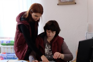 Yelena Glogovskaya (left), Viktoriya Gergert (right)Volunteer Social Workers at the Zaporozhye Baptist Union's City Aid Centre register incoming IDPs and provide assistance in securing housing, employment, and document restoration. Yelena was displaced by the conflict in Donetsk herself, but found support through this MCC partner and now offers her own gifts back as a volunteer for the City Aid Center. (MCC photo by Dan Leonard)
