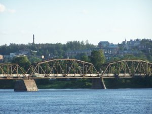 A railway-turned-pedestrian bridge crossing the Saint John River in Fredericton.