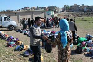 MCC's partner organization Iraqi al-Amal Association distributed material resources to internally-displaced Iraqis and Syrian refugees in the Kurdistan Region of Iraq. These materials -- including blankets, infant care kits, hygiene kits, and relief kits -- were donated by MCC constituents in the United States and Canada and provide much-needed assistance to individuals and families currently staying in Kirkuk and Erbil cities. Iraqi al-Amal Association supplemented the MCC-donated materials with other materials purchased in Iraq, providing a well-rounded distribution to meet the immediate needs of the recipients. (Photo by Salar Ahmed)