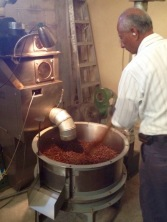 An employee of Cafe Justo demonstating how  coffee is roasted in Agua Prieta