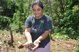 Guillarmina Castro with soil from her CA plot