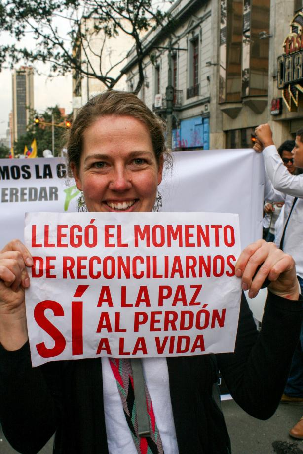 A woman holding a sign.
